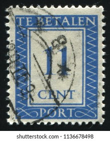 RUSSIA KALININGRAD, 21 JUNE 2017: stamp printed by Netherlands shows emblem, figure, number and symbol, circa 1947