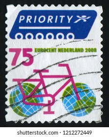 RUSSIA KALININGRAD, 21 JUNE 2017: stamp printed by Netherlands shows bicycle and globe, circa 2008