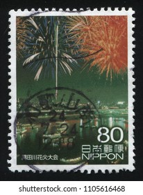 RUSSIA KALININGRAD, 22 APRIL 2016: stamp printed by Japan, shows afireworks in the sky over the river, circa 2010