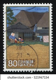 RUSSIA KALININGRAD, 22 APRIL 2016: stamp printed by Japan, shows a small village, two children playing in the yard and their mother, circa 2013