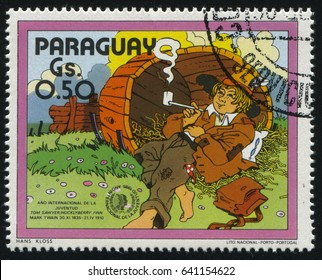 RUSSIA KALININGRAD, 22 APRIL 2017: stamp printed by Paraguay, shows Mark Twain Adventures of Tom Sawyer, circa 1985