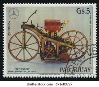 RUSSIA KALININGRAD, 22 APRIL 2017: stamp printed by Paraguay, shows Motocycle Reitwagen, Daimler-Maybach 1885, circa 1984