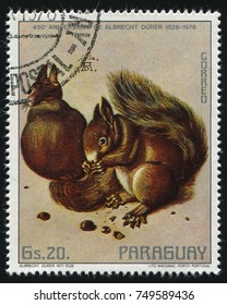 RUSSIA KALININGRAD, 22 APRIL 2017: stamp printed by Paraguay, shows painting by Albrecht Durer Squirrels and Acorn, circa 1978