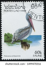 RUSSIA KALININGRAD, 26 MARCH 2019: stamp printed by Laos shows pelican, circa 1996