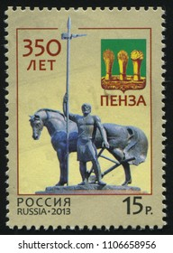 RUSSIA KALININGRAD, 27 OCTOBER 2016: stamp printed by Russia, shows the first settler of Penza with a pike and a plough in his hands standing near the horse, circa 2013
