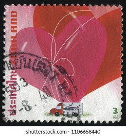 RUSSIA KALININGRAD, 3 JUNE 2016: stamp printed by Thailand, shows heart ballons in the lorry, circa 2004