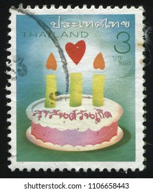 RUSSIA KALININGRAD, 3 JUNE 2016: stamp printed by Thailand, shows holiday cake with candles, circa 2005
