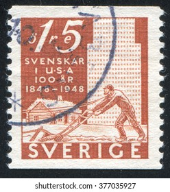 RUSSIA KALININGRAD, 8 SEPTEMBER 2013: stamp printed by Sweden, shows Plowman and buildings, circa 1948