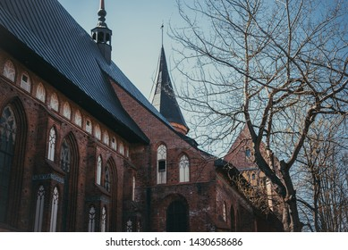 Russia, Kaliningrad - April 2019: The central part of the city of Kaliningrad, the Kaliningrad Cathedral on the island of Kant.