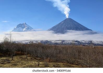 Russia, Kamchatka Peninsula. Klyuchevskaya sopkal(4800m) and Kamen Volcano(4585m) The volcano of Klyuchevskaya sopka (4800 m) is the highest active volcano of Eurasia.