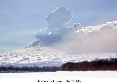Russia, Kamchatka Peninsula .MARCH-9,2017:Ashes emission by a volcano Bezymianny. Volcano Klyuchevskaya Sopka.Volcanoes Bezymianny(2880m,active) Klyuchevskoy(4800m)