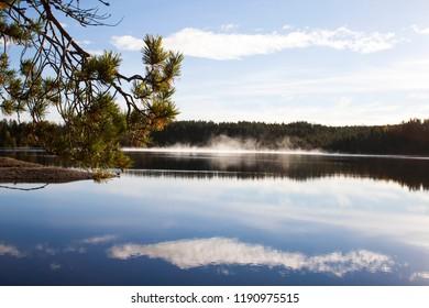 Russia. Karelia. Kostomuksha. Summer. Haze over the lake