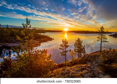 Russia. Karelia. Mirror reflection in water. Stones in the water. Ladoga lake.