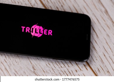 Russia, Kazan Apr 1, 2020: Triller Social Video Platform app icon on phone screen in blue jeans pocket with headphones. App Store logo on Iphone with earphones, Illustrative Edito