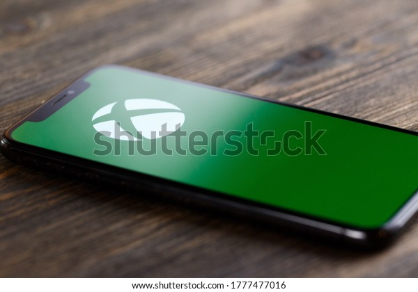 Russia, Kazan Apr 1, 2020: Xbox logo on phone screen flat lay with red background, Illustrative Editorial