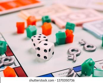 Russia, Kazan - April 3, 2019: Monopoly board game pieces.