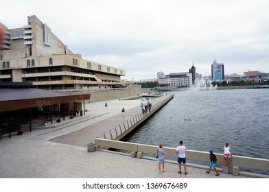 Russia, Kazan. July 21, 2018. Tourists and citizens walk along the waterfront near the Tatar academic theater named after Galiaskar Kamal .