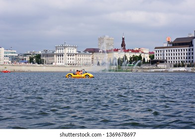 Russia, Kazan. July 21, 2018. Citizens relax boating on lake Kaban near the Tatar academic theatre named after Galiaskar Kamal.