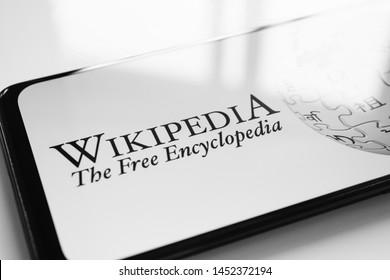RUSSIA, KAZAN MAY 1, 2019: Wikipedia logo on the phone screen on a white background