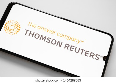 RUSSIA, KAZAN MAY 1, 2019:Thomson Reuters logo on a white background on the smartphone screen