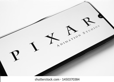 Russia, Kazan May 28, 2019: Pixar home page, view through a magnifying glass. Pixar company logo is visible. Soft focus.