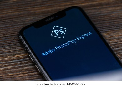Russia, Kazan May 28 2019: Photoshop logo on an iPhone X screen. Photoshop photo processing software.