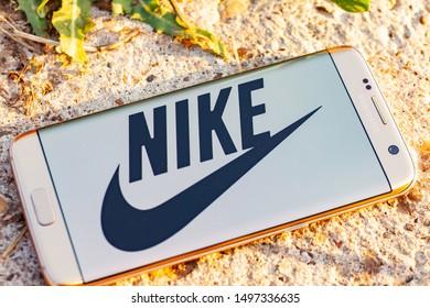 Russia, Kazan Sep 2 2019: Closeup of Nike logo label on green background. Nike logo. Nike is a global sports clothes