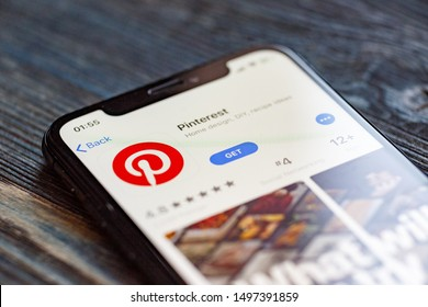 Russia, Kazan Sep 2 2019: Pinterest application icon on Apple iPhone X smartphone screen in jeans pocket. Pinterest app icon. Pinterest is Internet social network. Social media icon