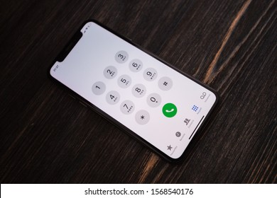 Russia, Kazan Sep 2 2019: iPhone X with call number on the screen. iPhone 10 was created and developed by the Apple inc.