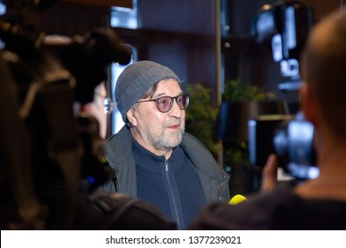 Russia Kemerovo 2019-02-26 Yuri Shevchuk frontman soloist of DDT rock band gives interviews to television channels, reporters in the hotel lobby before the concert