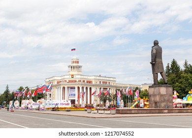 Russia, Kemerovo - July 21, 2018: Soviet Square, Monument to Lenin, Administration of the city of Kemerovo. City Council