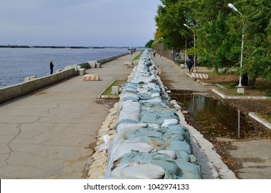 Russia, Khabarovsk, 09/23/2013. A view of the embankment on the Amur River. Sandbags for protection against flooding. Disasters and their prevention. Life in city.