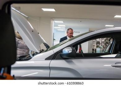 Russia, Kirov - December 05, 2016: Showroom and car Lada of dealership Gusar of factory Avtovaz in Kirov city in 2016