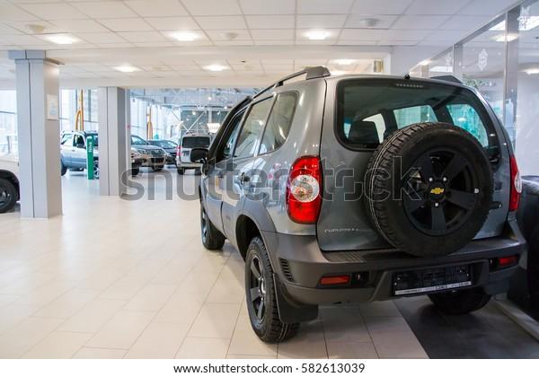 Russia, Kirov - December 06, 2016: Showroom of dealership Chevroled named Souz and car in it in Kirov city in 2016