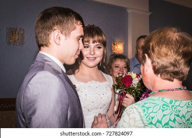 Russia, Kirov - July, 21, 2017: The bride and groom in the registry office during marriage and relatives around