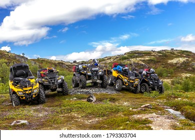 Russia, Kola Peninsula, June 20, 2013: group of ATVs Can-Am Outlander on top of a hill.