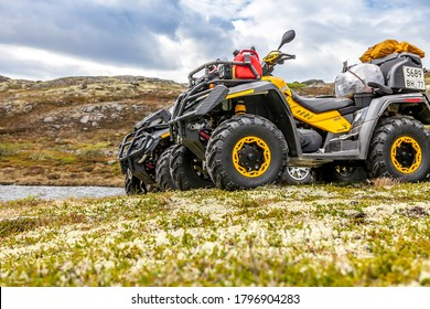 Russia, Kola Peninsula, June 20, 2013: group ATVs Can-Am Outlander on top of a hill.