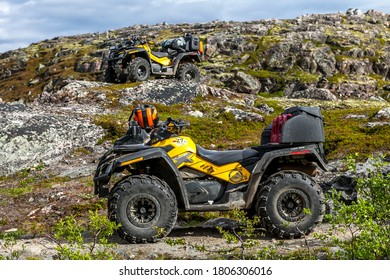 Russia, Kola Peninsula, June 20, 2013: ATVs Can-Am Outlander against the background of a arctic view. Art noise, selective focus, soft focus.