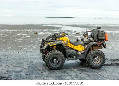 Russia, Kola Peninsula, June 21, 2013: BRP Can-Am Outlander ATV on the coast of the Barents Sea. Art noise, soft focus, selective focus, background. Close up.