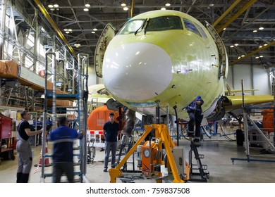 RUSSIA, KOMSOMOLSK-ON-AMUR - JUNE 27, 2014. Final assembly line of aircraft Sukhoi Superjet 100. Engineers and staff at work.