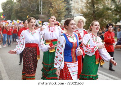 Russia , Krasnodar, 23.09.17 procession of students of the Institute of culture in traditional Russian and Ukrainian costumes, the girls sing, the boys are accompanied on the accordion, colorful