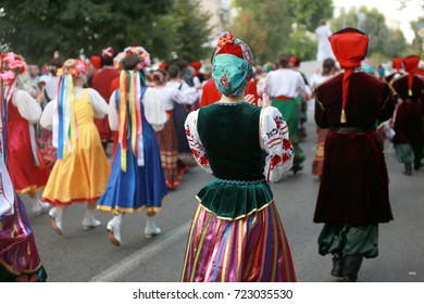 Russia, Krasnodar 23.09.17 procession of students of the Institute of culture, dancers in Cossack traditional dress, colored skirt, green trousers and maroon jackets, Cossack hats Cossacks dancing
