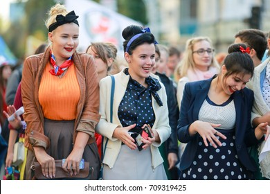 Russia, Krasnodar, 26.09.2016 procession of students through the streets students in the clothing style of 50-60 years,autumn, retro car, dancers,Boogie woogie, bright skirts, bright ties, retro style