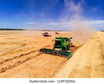 Russia, Krasnodar region, 02 July 2018. Harvester machine to harvest wheat field working. Combine harvester agriculture machine harvesting golden ripe wheat field. Agriculture. Aerial view