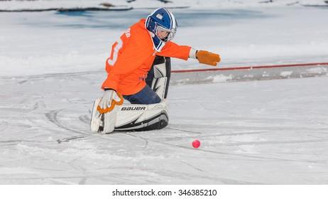 RUSSIA, KRASNOGORSK - NOVEMBER 15, 2015: Zorky-Vimpel 4:4, training match boys under 12 hockey League bandy, Russia.