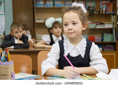 Russia, Krasnoyarsk region, Igarka, December 2015: back to school. the girl sits at her Desk and attentively listens to the teacher.