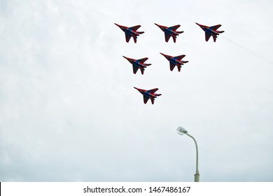 Russia, Magnitogorsk, - July, 19, 2019. Six Russian Fulcrum-A MiG 29 fighters fly over the city. Military equipment