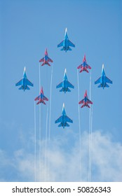 RUSSIA, MAKS - AUGUST 26: SU-27 and MIG-29 fighters performing group aerobatic elements at MAKS  aviation salon August 26, 2007 in Zhukovski, Russia