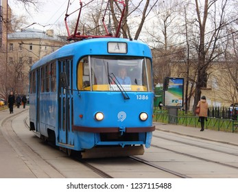 """Russia / Moscow - 04 12 2017: Blue old tram route """"A"""" (""""Annushka"""") drive in the center of Zamoskvorechye - urban passenger transport, city tramway in the spring day"""