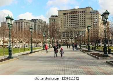 Russia / Moscow - 04 12 2017: Hotel Four Seasons (ex Moscow), view from alley with walking people in Alexander garden in the spring sunny day against the blue sky with clouds